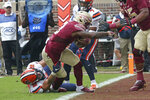 Florida State's Cam Akers, center, breaks the tackle of Syracuse's Andrew Armstrong to score during the first quarter of an NCAA college football game, Saturday, Oct. 26, 2019, in Tallahassee Fla. (AP Photo/Steve Cannon)