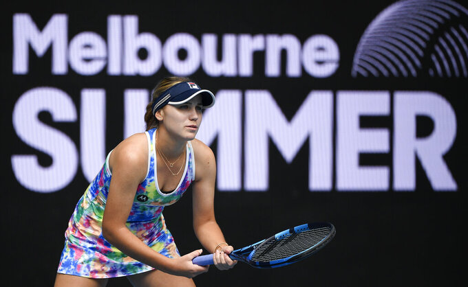 United States' Sofia Kenin waits to receive serve from Italy's Camila Giorgi during their match at a tuneup tournament ahead of the Australian Open tennis championships in Melbourne, Australia, Tuesday, Feb. 2, 2021. (AP Photo/Andrew Brownbill)