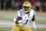 CORRECTS MONTH TO SEPTEMBER INSTEAD OF OCTOBER - UCLA defensive back Darnay Holmes drops back in coverage against Arizona in the first half during an NCAA college football game, Saturday, Sept. 28, 2019, in Tucson, Ariz. (AP Photo/Rick Scuteri)