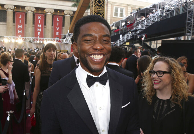 FILE - In this Feb. 28, 2016 file photo, Chadwick Boseman arrives at the Oscars in Los Angeles.  Boseman, who played Black icons Jackie Robinson and James Brown before finding fame as the regal Black Panther in the Marvel cinematic universe, has died of cancer. His representative says Boseman died Friday, Aug. 28, 2020 in Los Angeles after a four-year battle with colon cancer. He was 43.  (Photo by Matt Sayles/Invision/AP, File)
