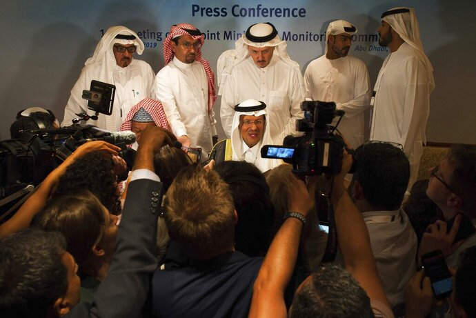 Saudi Energy Minister Prince Abdulaziz bin Salman speaks to journalists after a news conference that followed an OPEC meeting in Abu Dhabi, United Arab Emirates, Thursday, Sept. 12, 2019. OPEC's Joint Ministerial Monitoring Committee met Thursday in Abu Dhabi as estimates of lowered crude oil demand in 2020 have the cartel considering additional production cuts. Before the meeting started, Prince Abdulaziz again called for
