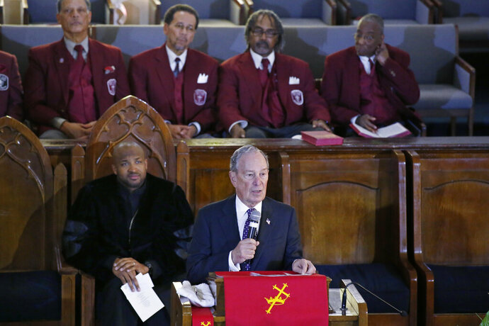 Democratic Presidential candidate Michael Bloomberg, right, speaks during a service at the Vernon American Methodist Episcopal Church in Tulsa, Okla., Sunday, Jan. 19, 2020, as the Rev. Robert Turner looks on at left. (AP Photo/Sue Ogrocki)