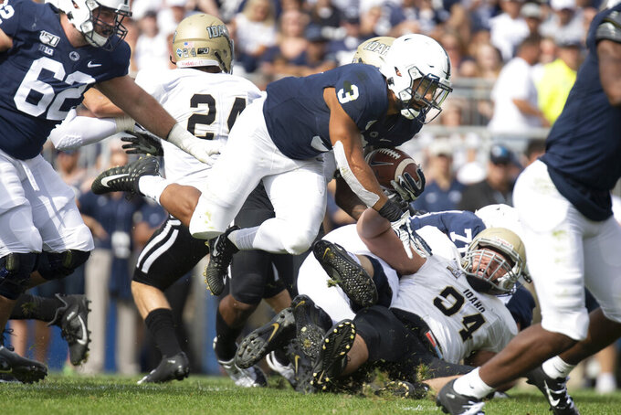 Penn State running back Ricky Slade (3) drives over an Idaho defender in the first quarter of an NCAA college football game in State College, Pa., on Saturday, Aug. 31, 2019. (AP Photo/Barry Reeger)