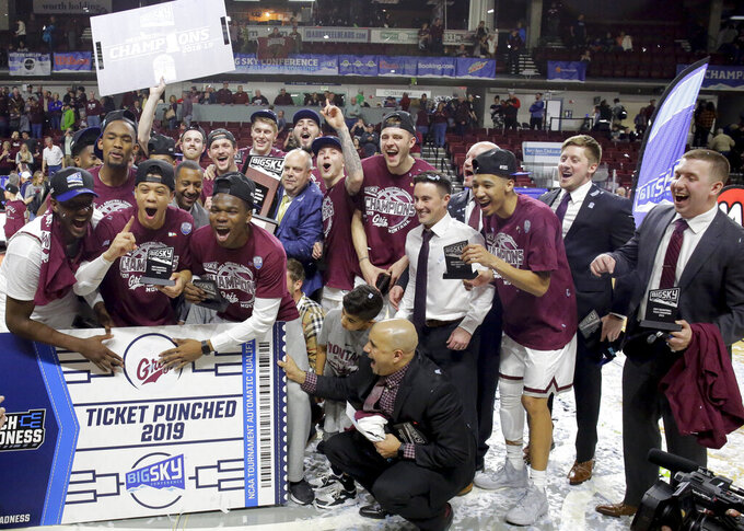 Montana celebrates their 68-62 win over Eastern Washington in an NCAA college basketball game in the championship of the Big Sky Tournament in Boise, Idaho, Saturday, March 16, 2019. (AP Photo/Otto Kitsinger)