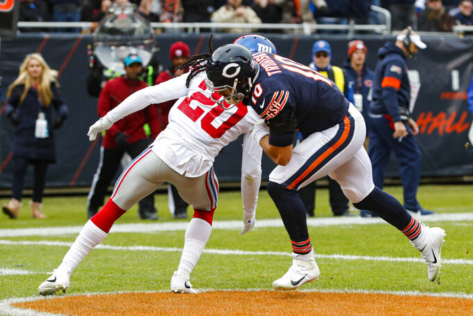 Chicago Bears quarterback Mitchell Trubisky (10) runs in for a touchdown behind New York Giants cornerback Janoris Jenkins (20) during the second half of an NFL football game in Chicago, Sunday, Nov. 24, 2019. (AP Photo/Charles Rex Arbogast)
