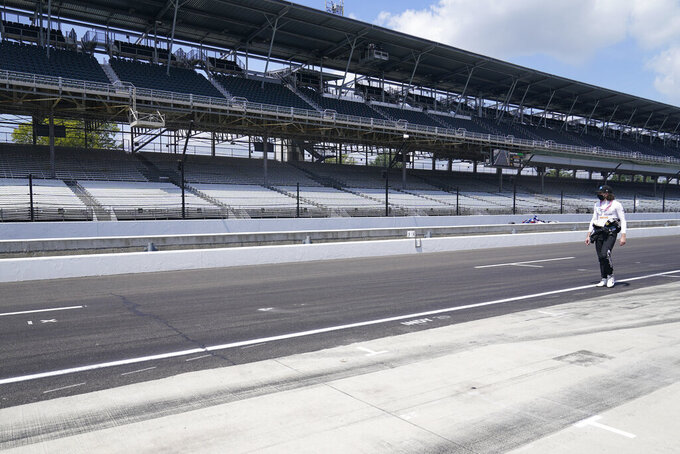 J.R. Hildebrand walks down pit lane during qualifications for the Indianapolis 500 auto race at Indianapolis Motor Speedway, Saturday, Aug. 15, 2020, in Indianapolis. (AP Photo/Darron Cummings)