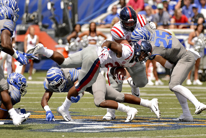 Mississippi running back Scottie Phillips (22) is tackled on a carry in the second half of an NCAA college football game against Memphis, Saturday, Aug. 31, 2019, in Memphis, Tenn. (AP Photo/Brandon Dill)