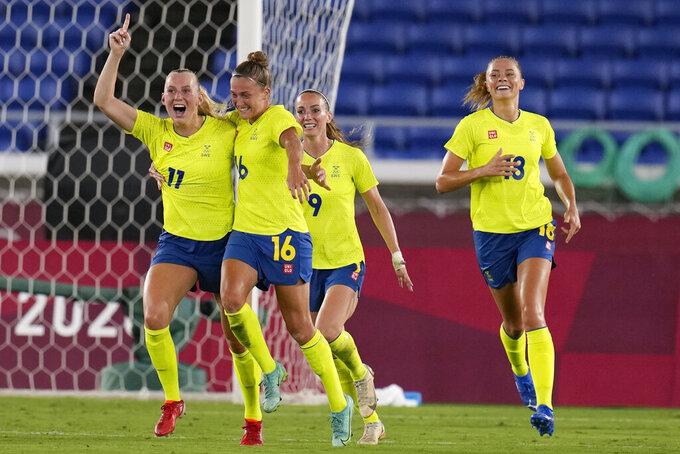 Sweden's Stina Blackstenius celebrates scoring the opening goal against Canada in the women's soccer match for the gold medal at the 2020 Summer Olympics, Friday, Aug. 6, 2021, in Yokohama, Japan. (AP Photo/Fernando Vergara)