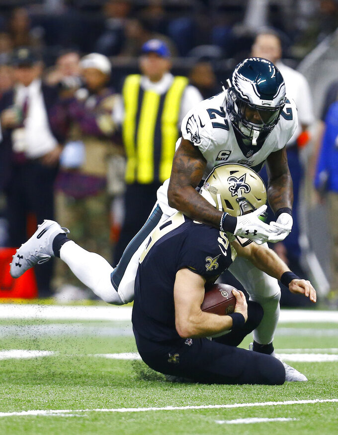 Philadelphia Eagles strong safety Malcolm Jenkins (27) sacks New Orleans Saints quarterback Drew Brees (9) in the first half of an NFL divisional playoff football game in New Orleans, Sunday, Jan. 13, 2019. (AP Photo/Butch Dill)