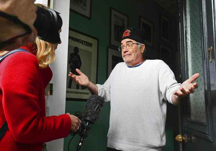 Danny Baker speaks to the media at his London home on Thursday, May 9, 2019. A BBC DJ has been fired after using a picture of a chimpanzee in a tweet about the royal baby born to Meghan the Duchess of Sussex and her husband Prince Harry. Danny Baker tweeted Thursday that he has been fired after posting an image of a couple holding hands with a chimpanzee dressed in clothes and the caption: