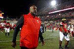 FILE - In this Nov. 23, 2019, file photo, Maryland head coach Mike Locksley walks off the field after losing to Nebraska in an NCAA college football game in College Park, Md. As Locksley enters his second season as the helm, he deals with quarterback Josh Jackson opting out of the 2020 season because of the COVID-19 pandemic and Tyrrell Pigrome has transferred to Western Kentucky. Alabama transfer Taulia Tagovailoa and redshirt freshman Lance Legendre have been competing for the starting spot this fall. (AP Photo/Will Newton, File)