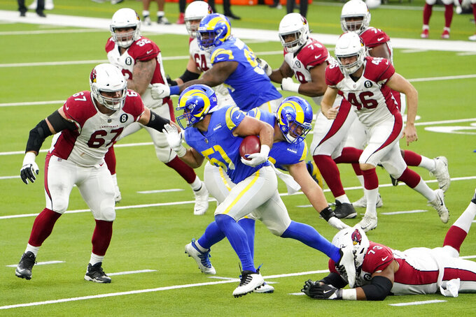 Los Angeles Rams linebacker Troy Reeder (51) runs with the ball after the Rams blocked a field goal attempt by the Arizona Cardinals during the second half of an NFL football game in Inglewood, Calif., Sunday, Jan. 3, 2021. (AP Photo/Jae C. Hong)