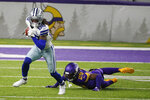 Dallas Cowboys wide receiver CeeDee Lamb (88) runs from Minnesota Vikings cornerback Kris Boyd (29) during the second half of an NFL football game, Sunday, Nov. 22, 2020, in Minneapolis. The Cowboys won 31-28.(AP Photo/Bruce Kluckhohn)