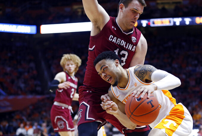 Tennessee guard Lamonte Turner (1) drives against South Carolina forward Felipe Haase (13) during the second half of an NCAA college basketball game Wednesday, Feb. 13, 2019, in Knoxville, Tenn. Tennessee won 85-73. (AP photo/Wade Payne)