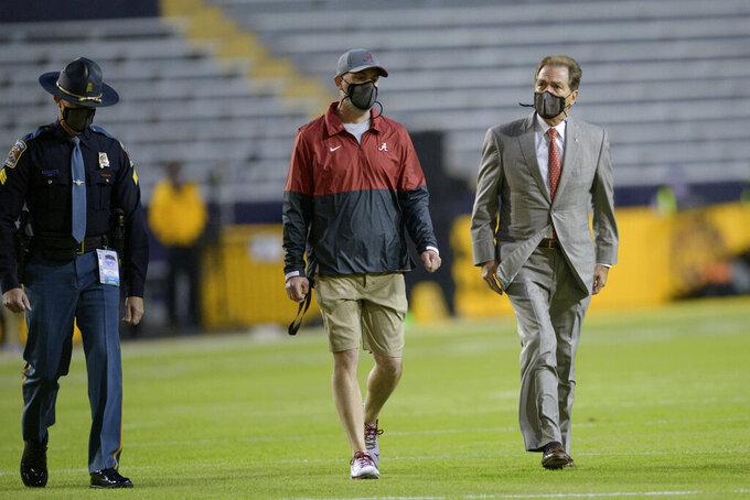 Alabama head coach Nick Saban arrives before an NCAA college football game against LSU in Baton Rouge, La., Saturday, Dec. 5, 2020. (AP Photo/Matthew Hinton)
