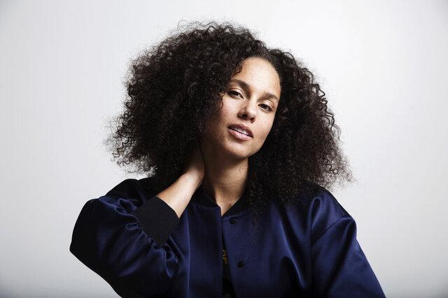 FILE - In this Nov. 2, 2016 file photo, Alicia Keys poses for a portrait in New York. Keys' memoir