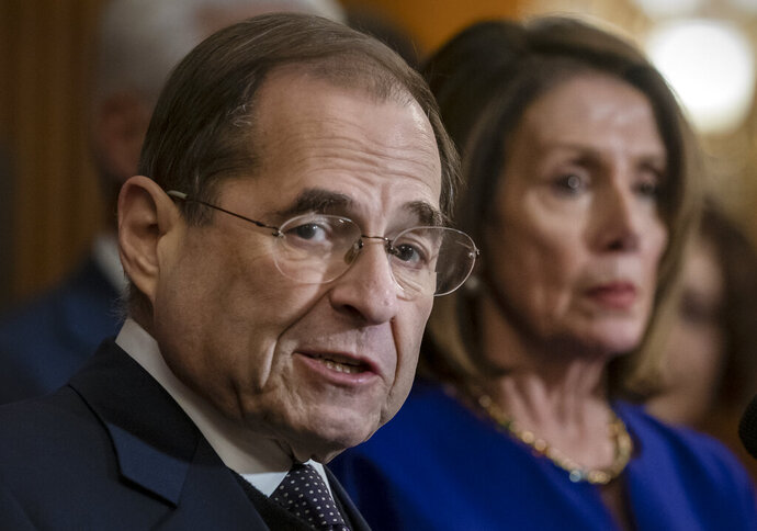"""FILE - In this March 7, 2019, file photo, House Judiciary Committee Chairman Jerrold Nadler, D-N.Y., and Speaker of the House Nancy Pelosi, D-Calif., speak to reporters at the Capitol in Washington. The House Judiciary Committee is moving to the forefront of President Donald Trump's impeachment, starting with a hearing Wednesday, Dec. 4 to examine the """"high crimes and misdemeanors"""" set out in the Constitution. (AP Photo/J. Scott Applewhite, File)"""