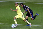 Nashville SC midfielder Randall Leal (8) controls the ball past Montreal Impact defender Jorge Luis Corrales (26) during the first half of an MLS soccer match Tuesday, Oct. 27, 2020, in Harrison, N.J. (AP Photo/Adam Hunger)