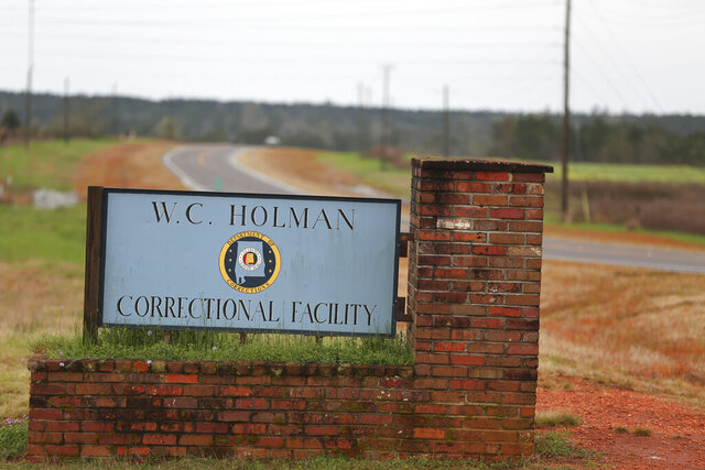 FILE -In this March 12, 2016 file photo, the sign to The William C. Holman Correctional Facility in Atmore, Ala., is displayed.  The Alabama Department of Corrections on Jan. 28, 2020 announced plans to largely shutter Holman Correctional Facility because of infrastructure problems.   (Sharon Steinmann/AL.com via AP, File)