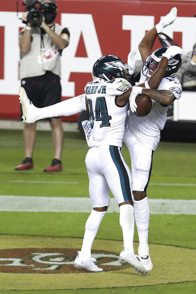 Philadelphia Eagles wide receiver Travis Fulgham, right, is congratulated by wide receiver Greg Ward Jr. after scoring a touchdown against the San Francisco 49ers during the second half of an NFL football game in Santa Clara, Calif., Sunday, Oct. 4, 2020. (AP Photo/Jed Jacobsohn)