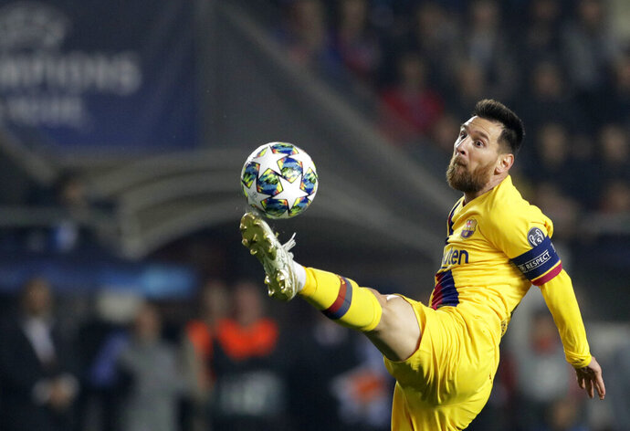 Barcelona's Lionel Messi kicks the ball during the Champions League group F soccer match between Slavia Praha and FC Barcelona at the Sinobo stadium in Prague, Czech Republic, Wednesday, Oct. 23, 2019. (AP Photo/Petr David Josek)