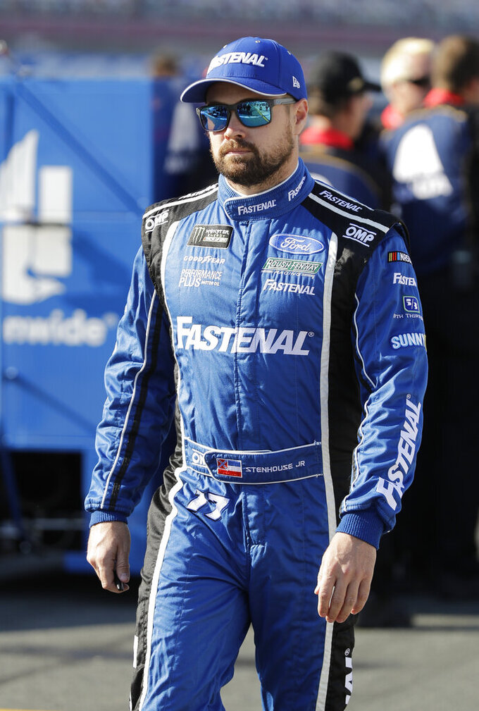 Ricky Stenhouse Jr. walks down pit road before qualifying for Saturday's NASCAR All-Star Cup series auto race at Charlotte Motor Speedway in Concord, N.C., Friday, May 17, 2019. (AP Photo/Chuck Burton)