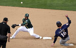 The ball bounces away from Oakland Athletics second baseman Jurickson Profar, second from left, as Milwaukee Brewers' Ben Gamel, right, slides safely into second base for a stolen base in the sixth inning of a spring training baseball game Saturday, March 9, 2019, in Mesa, Ariz. (AP Photo/Elaine Thompson)