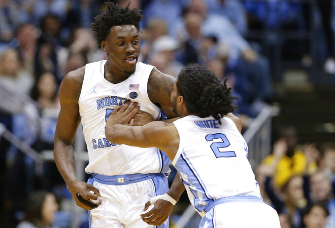 North Carolina's Nassir Little, left, and Coby White (2) react following a play against Virginia Tech during the second half of an NCAA college basketball game in Chapel Hill, N.C., Monday, Jan. 21, 2019. (AP Photo/Gerry Broome)