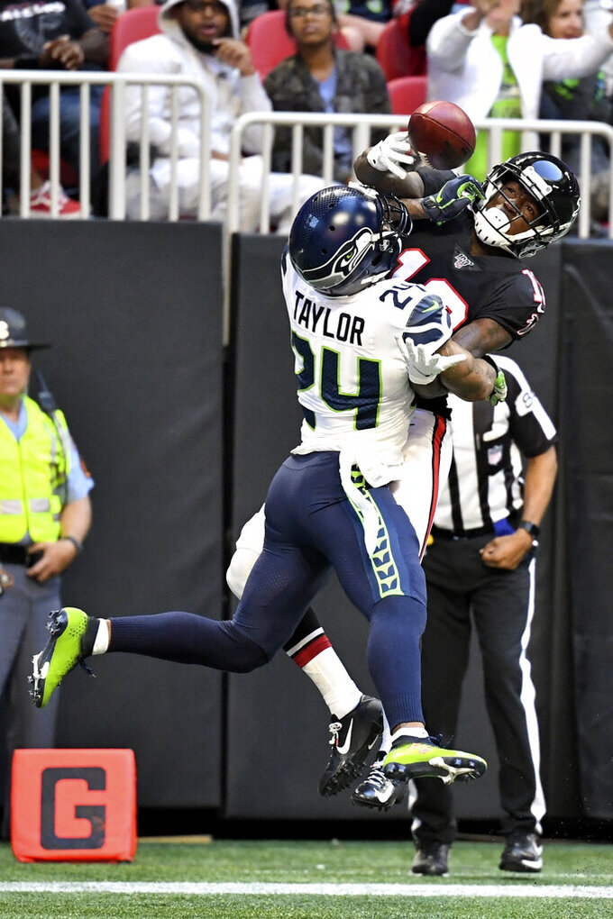 Atlanta Falcons wide receiver Calvin Ridley (18) misses the catch against Seattle Seahawks cornerback Jamar Taylor (24) during the second half of an NFL football game, Sunday, Oct. 27, 2019, in Atlanta. The Seattle Seahawks won 27-20. (AP Photo/Danny Karnik)