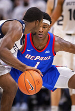 DePaul forward Romeo Weems (1) watches the ball while Butler guard Kamar Baldwin (3) works it around the court during the second half of an NCAA college basketball game, Saturday, Feb. 29, 2020, in Indianapolis. (AP Photo/Doug McSchooler)