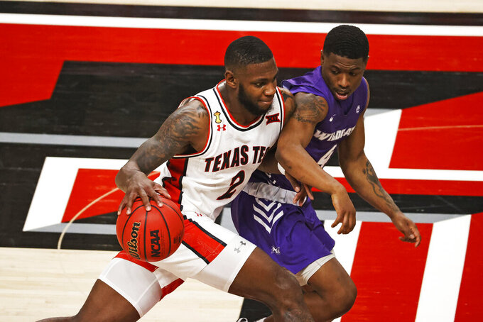Texas Tech's Jamarius Burton (2) dribbles around Abilene Christian's Damien Daniels (4) during the first half of an NCAA college basketball game Wednesday, Dec. 9, 2020, in Lubbock, Texas. (AP Photo/Brad Tollefson)