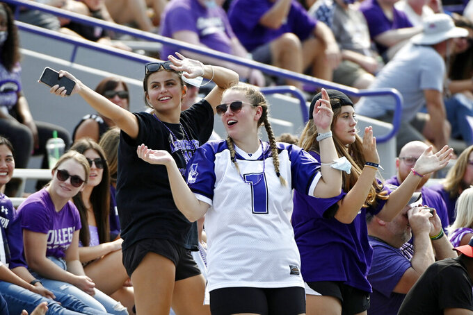 Northwestern fans cheer during the first half of an NCAA college football game against Indiana State in Evanston, Ill, Saturday, Sept.11, 2021. (AP Photo/Matt Marton)