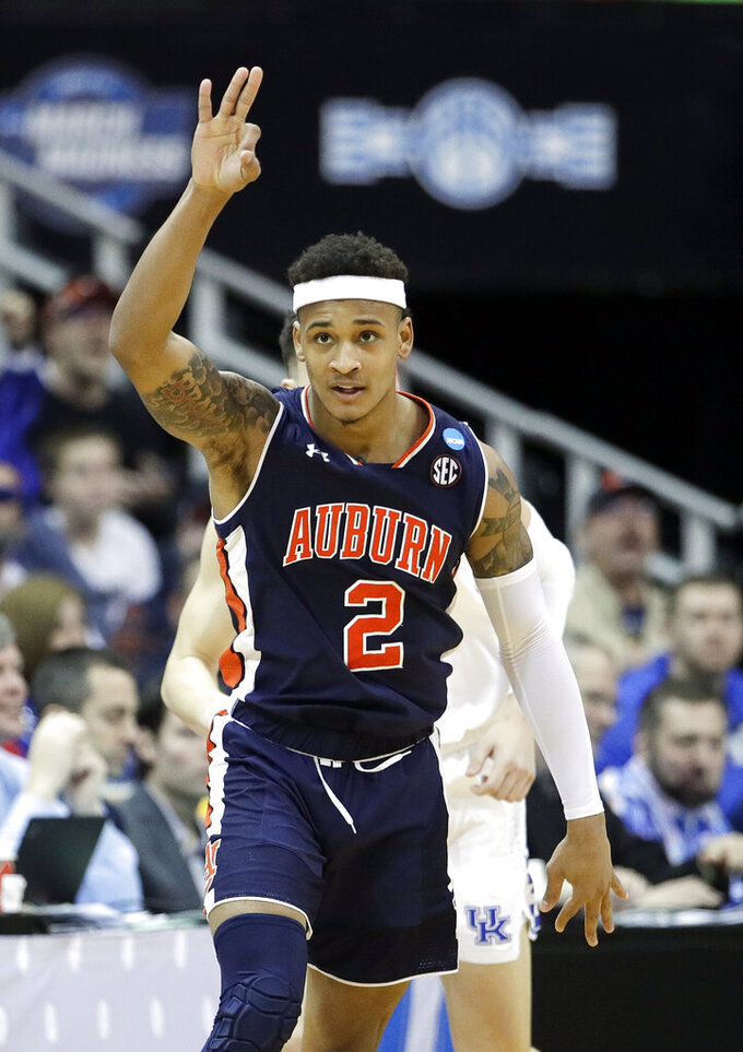 Auburn's Bryce Brown celebrates after making a 3-point basket during the second half of the Midwest Regional final game against Kentucky in the NCAA men's college basketball tournament Sunday, March 31, 2019, in Kansas City, Mo. (AP Photo/Charlie Riedel)
