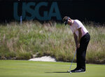 Ian Poulter, of England, putts on the 16th green during the first round of the U.S. Open Golf Championship, Thursday, June 14, 2018, in Southampton, N.Y. (AP Photo/Seth Wenig)