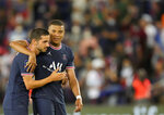 PSG's Pablo Sarabia, left, and PSG's Kylian Mbappe celebrate at the end of the French League One soccer match between Paris Saint Germain and Strasbourg, at the Parc des Princes stadium in Paris, Saturday, Aug. 14, 2021. (AP Photo/Francois Mori)
