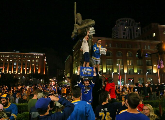 St. Louis Blues fans celebrate the team's win against the Boston Bruins in Game 7 of the NHL hockey Stanley Cup Final in Boston, outside Busch Stadium in St. Louis after a watch party for the game was held in the baseball stadium Wednesday, June 12, 2019. (David Carson/St. Louis Post-Dispatch via AP)