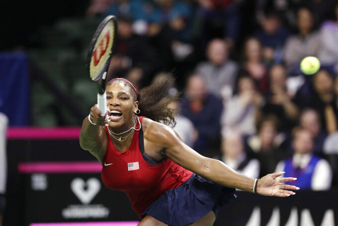 "FILE - In this Saturday, Feb. 8, 2020 file photo, Serena Williams returns a shot against Latvia's Anastasija Sevastova during a Fed Cup qualifying tennis match in Everett, Wash. On Friday, June 26, 2020, The Associated Press reported on stories circulating online incorrectly asserting in a Facebook post, tennis star Serena Williams said that she was sick of COVID-19, black versus white, gay versus straight and Democrats versus Republicans, and that people should ""stop thrusting your beliefs on others."" This is a case of mistaken identity. Another Facebook user named Serena Williams shared the comments. (AP Photo/Elaine Thompson)"