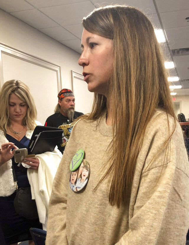 Cristi Cain speaks to reporters after appearing at a hearing where Alabama lawmakers granted initial approval to a bill allowing medical marijuana, Wednesday, Feb. 19, 2020, in Montgomery, Ala. Cain said her 8-year-old son had as many as 100 seizures daily before starting CBD oil, and the number has since been drastically reduced. (AP Photo/Kim Chandler)