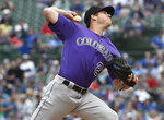 Colorado Rockies starting pitcher Peter Lambert (23) delivers against the Chicago Cubs during the first inning of a baseball game, Thursday, June, 6, 2019, in Chicago. (AP Photo/David Banks)