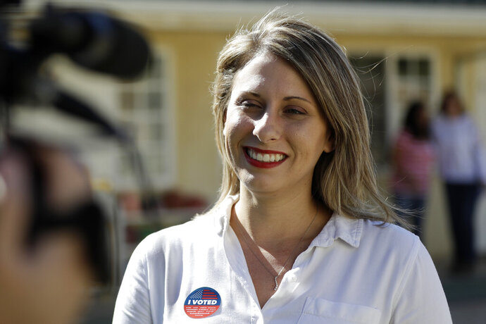 "FILE - In this Nov. 6, 2018, file photo, Katie Hill speaks during an interview after voting in Agua Dulce, Calif.  Hill announced her resignation over the weekend following the publication of explicit photos that outed the relationship. She describes the photos as ""revenge porn"" and is vowing to fight the problem so that women and girls don't shy away from politics in the future. Hill's resignation  in a sex scandal she blamed on an abusive husband has observers wondering if women are held to higher standards in public life and what the future holds for politicians coming of age in the iPhone era. (AP Photo/Marcio Jose Sanchez, File)"