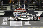 FILE - In this June 10, 2017, file photo, Will Power, of Australia, pumps his fist as he crosses the finish line under yellow to win an IndyCar auto race at Texas Motor Speedway, in Fort Worth, Texas. IndyCar is getting ready for an all-in-one-day season opener on the fast track in Texas, more than 2 ½ months after drivers were set to roll on the streets of St. Pete. The pandemic-delayed season is now set to open Saturday, June 6, 2020. (AP Photo/Tony Gutierrez, File)