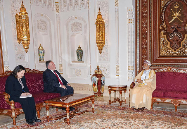 In this photo released by the state-run Oman News Agency, U.S. Secretary of State Mike Pompeo, center, meets with Oman's Sultan Haitham bin Tariq in Muscat, Oman, Thursday, Aug. 27, 2020. Pompeo visited Oman's new sultan on Thursday, the last stop on a Mideast trip that sought to build on an American-brokered deal to have Israel and the United Arab Emirates normalize relations. (Oman News Agency via AP)