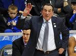 Duke head coach Mike Krzyzewski shouts instructions during the first half of an NCAA men's college basketball tournament second-round game against Rhode Island, in Pittsburgh, Saturday, March 17, 2018. Duke won 87-62. (AP Photo/Gene J. Puskar)