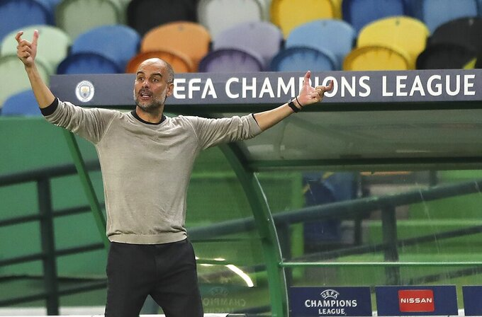Manchester City's head coach Pep Guardiola reacts during the Champions League quarterfinal soccer match between Lyon and Manchester City at the Jose Alvalade stadium in Lisbon, Portugal, Saturday, Aug. 15, 2020. (Miguel A. Lopes/Pool via AP)
