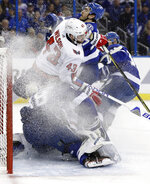 Washington Capitals right wing Tom Wilson (43) crashes into Tampa Bay Lightning goaltender Andrei Vasilevskiy (88) during the first period of Game 2 of the NHL Eastern Conference finals hockey playoff series Sunday, May 13, 2018, in Tampa, Fla. Wilson was penalized on the play. (AP Photo/Chris O'Meara)