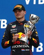 Red Bull driver Max Verstappen of Netherlands hols a trophy after winning second place during the Russian Formula One Grand Prix at the Sochi Autodrom circuit, in Sochi, Russia, Sunday, Sept. 26, 2021. (Yuri Kochetkov/Pool Photo via AP)