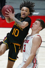 Arizona State guard Jaelen House (10) goes to the basket as Utah guard Pelle Larsson, right, defends in the first half during an NCAA college basketball game Saturday, March 6, 2021, in Salt Lake City. (AP Photo/Rick Bowmer)