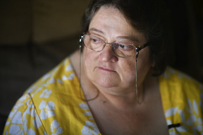 """THIS CORRECTS THE SPELLING OF THE LAST NAME TO  KELLEY, AND NOT KELLY AS ORIGINALLY SENT - Doris Kelley, 57, sits in her home on Monday, June 29, 2020 in Ruffs Dale, Pa. Kelley was one of the first patients in a University of Pittsburgh Medical Center trial for COVID-19. """"It felt like someone was sitting on my chest and I couldn't get any air,"""" Kelley said of the disease. (AP Photo/Justin Merriman)"""