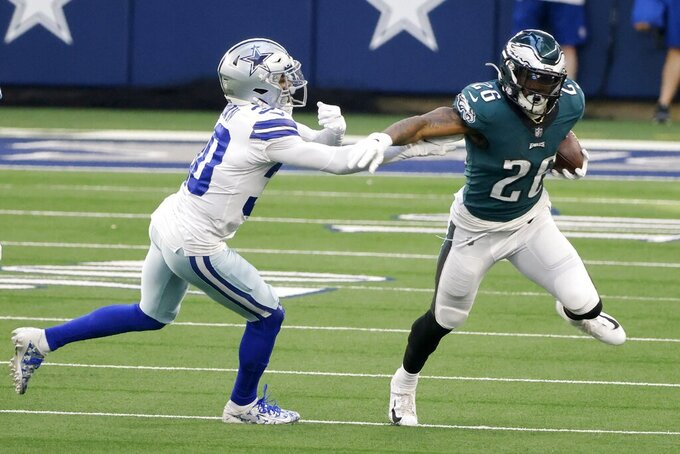 Dallas Cowboys cornerback Anthony Brown (30) attempts to stop Philadelphia Eagles running back Miles Sanders (26) in the first half of an NFL football game in Arlington, Texas, Sunday, Dec. 27. 2020. (AP Photo/Michael Ainsworth)