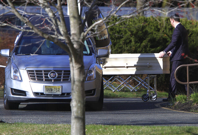 FILE- In this April 3, 2019, file photo, a casket is wheeled into the Congregation Beth Chaim in Princeton Junction, N.J., where funeral services were scheduled for Samantha Josephson. Legislation stemming from the death of Josephson, the New Jersey woman and South Carolina student police say got into the car of an Uber impersonator, passed the U.S. House on Wednesday, July 29, 2020. (Thomas P. Costello/The Asbury Park Press via AP, File)